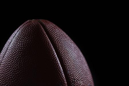 Close-up of American football against black background Reklamní fotografie