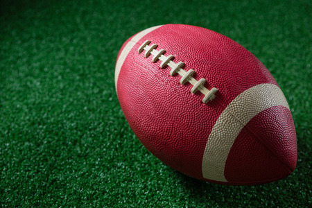 Close-up of American football on artificial turf Stock Photo