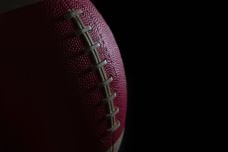 Close-up of American football against black background Stock Photo