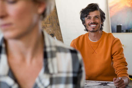Portrait of smiling man in sitting at table art class