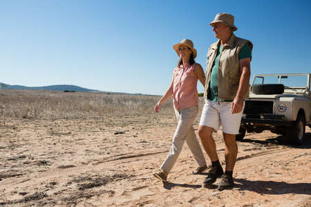 Full length of couple walking on landscape