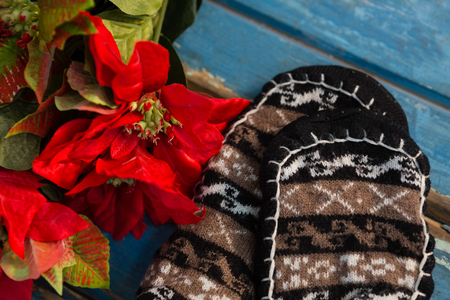 Close up of poinsettia by socks on table on wooden table Stock Photo