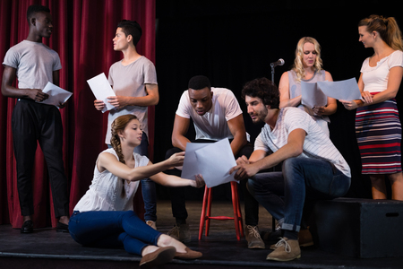 Actors reading their scripts on stage in theatre Banco de Imagens - 84502903