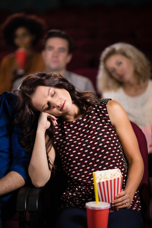 Young woman sleeping in theatre