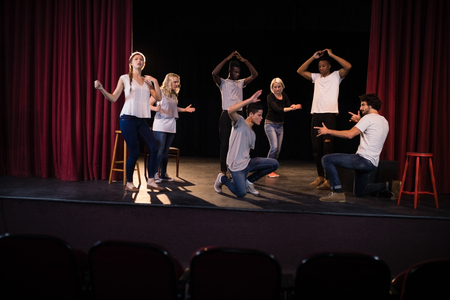 Actors practicing play on stage in theatre Stok Fotoğraf - 84503037