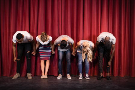 Actors bowing on the stage in theatre
