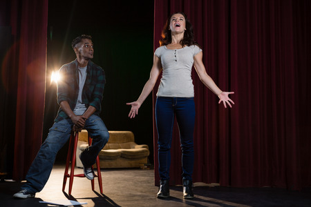 Artists rehearsing on stage in theatre Stock Photo