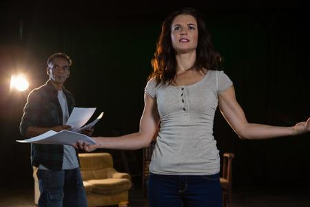 Artists rehearsing on stage in theatre Standard-Bild