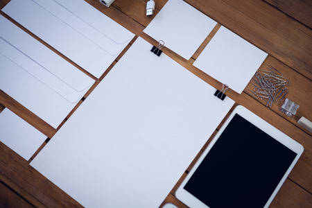 life extension: Envelopes with technologies and office supply on wooden table Stock Photo