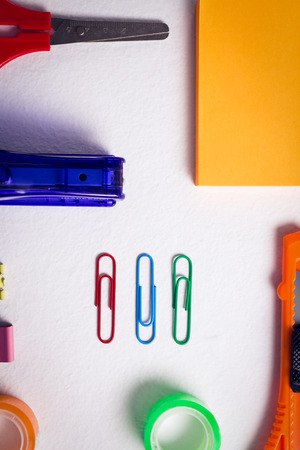 office stapler: Close-up of various stationery on white background