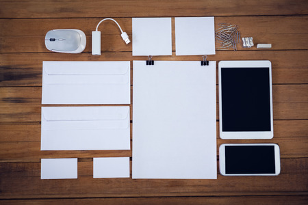 life extension: Overhead view of envelopes with technologies and office supply on wooden table