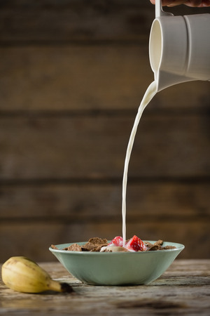 Close-up of milk being poured in wheat flakes