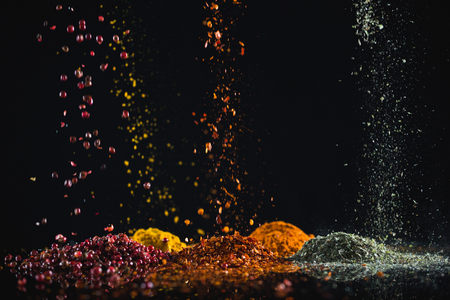 Close-up of powdered spices against black background