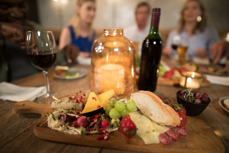 Various food and drink on dining table in restaurant