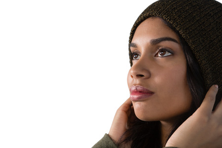 contemplated: Close up of thoughtful young woman against white background Stock Photo