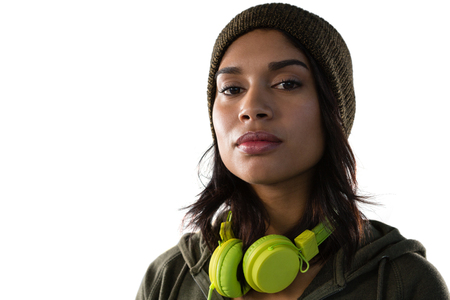 Close up portrait of confident young woman with headphones against white background
