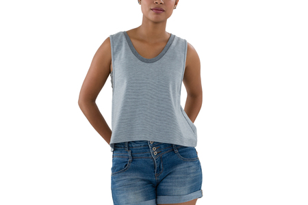 Mid section of young woman in casual clothing against white background