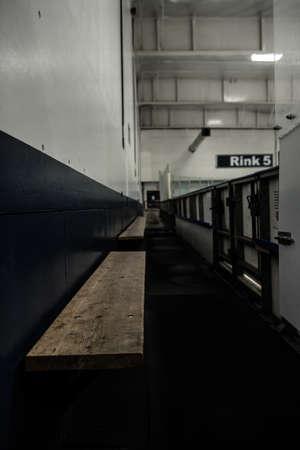 Empty seats at corridor in ice hockey rink