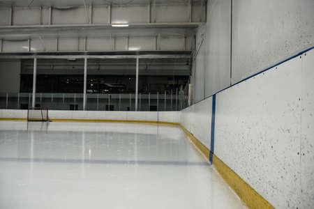 Empty illuminated ice hockey rink LANG_EVOIMAGES