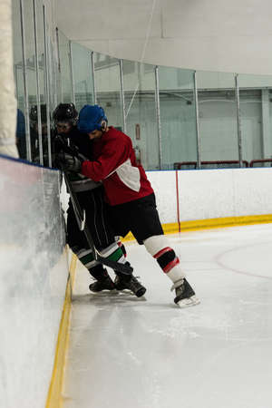 Full length of male ice hockey players playing at rink