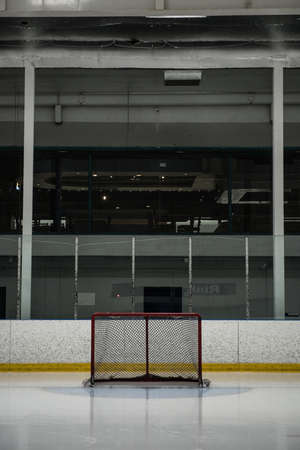 Goal post at empty ice hockey rink LANG_EVOIMAGES