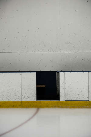Gap in white wall at ice hockey rink