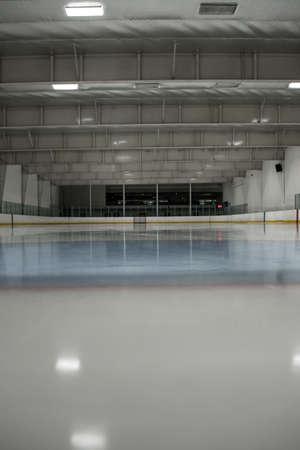 Illuminated empty ice hockey rink
