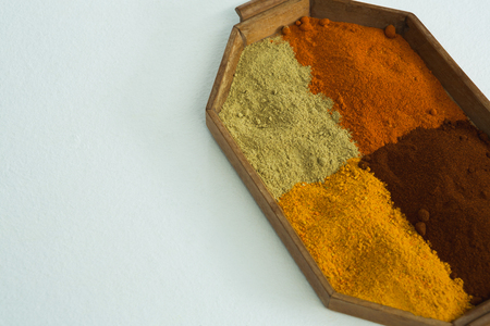 Close-up of various spices in tray