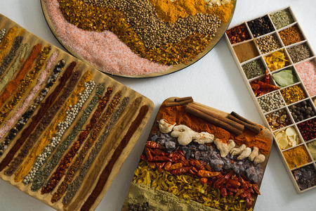 Overhead of various spices arranged in tray