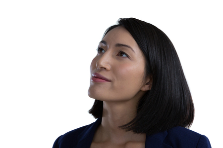 Close-up of thoughtful businesswoman against white background