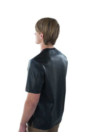 contemplated: Rear view of man standing against white background