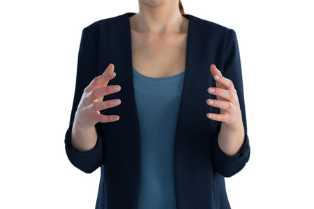 Mid section of businesswoman gesturing during presentation against white background