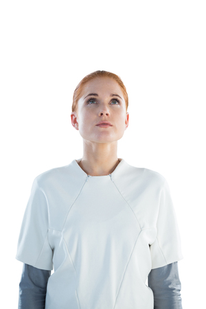 contemplated: Thoughtful businesswoman looking up while standing against white background