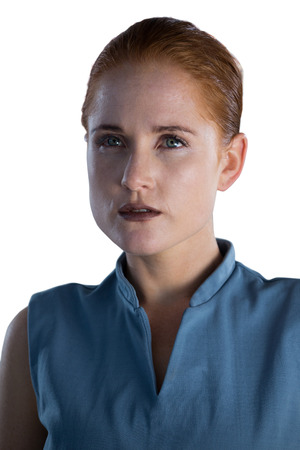contemplated: Close up of thoughtful businesswoman with gray eyes against white background