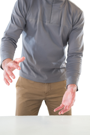Mid section of businessman promoting invisible product during presentation against white background