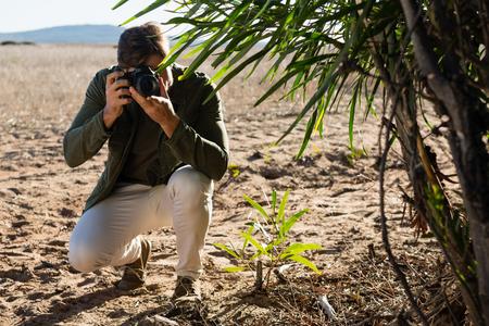 Man photographing from camera on landscape Lizenzfreie Bilder