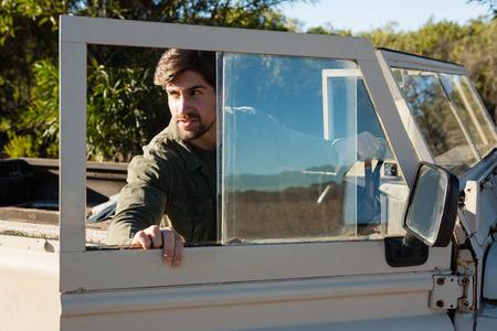 Man opening off road vehicle door