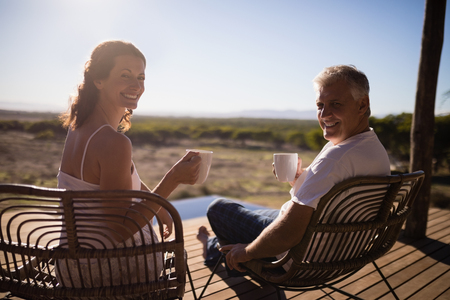 Portrait of senior couple having coffee while sitting at the resort