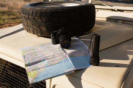 Spare tire with map and camera on vehicle hood