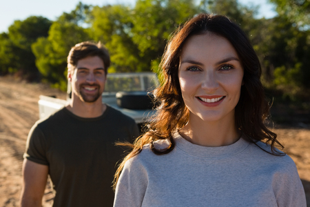 Portrait of beautiful young woman standing by man