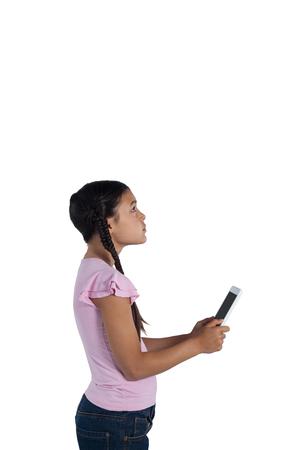 Thoughtful girl holding digital tablet against white background