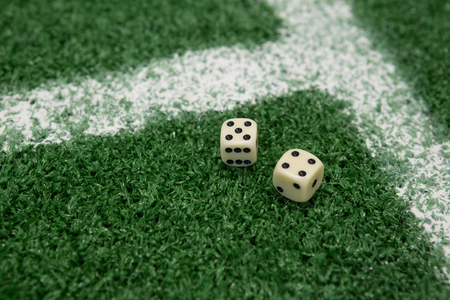 Close-up of two dices on artificial grass Stock Photo