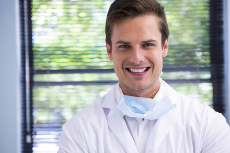 Portrait of smiling doctor at dental clinic