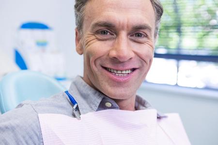 Portrait of man smiling at dental clinic Stock Photo
