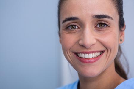 Closeup of beautiful woman smiling at dentist clinic Stock Photo