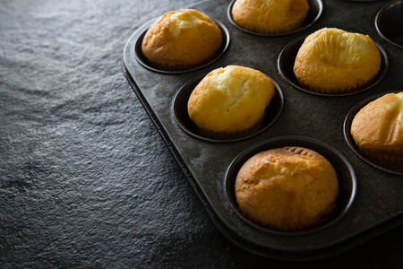 Close-up of plain cupcakes on baking tray Banco de Imagens - 87847928