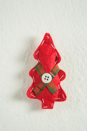 personal ornaments: Close-up of handmade christmas tree on white background