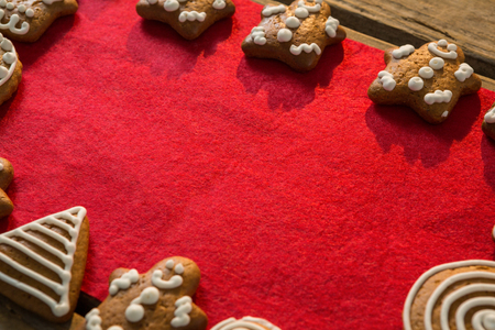 Close up of gingerbread cookies arranged on red fabric at table