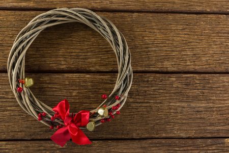 Overhead view of wreath with ribbon on wooden table Stock Photo