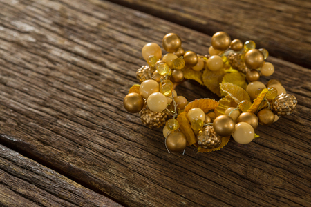 close uo: Close uo of golden Christmas decoration on wooden table